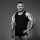 Handsome muscular man in studio Stock Image