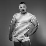 Handsome muscular man in studio Stock Images