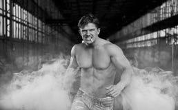 Handsome muscular man walking Stock Photos