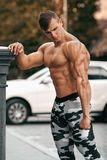 Handsome muscular man working out outdoor. Strong male naked torso abs, outside.  Royalty Free Stock Images