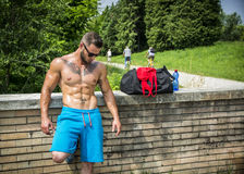Handsome Muscular Shirtless Hunk Man Outdoor in City Park Royalty Free Stock Images