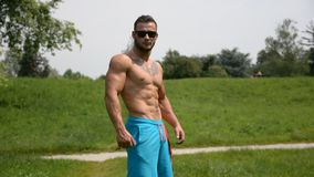 Handsome Muscular Shirtless Hunk Man Outdoor in City Park stock video footage