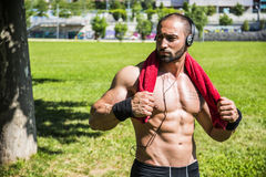 Handsome Muscular Shirtless Hunk Man Outdoor in City Setting Royalty Free Stock Photos