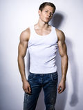 Handsome muscular young bodybuilder showing his muscles and abs Royalty Free Stock Photo