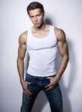 Handsome muscular young bodybuilder showing his muscles and abs Stock Images