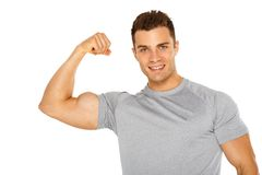 Handsome muscular young man isolated on white Stock Photos