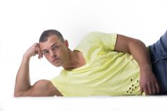 Handsome, muscular young man leaning on the floor Royalty Free Stock Images