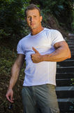 Handsome muscular young man outdoor Royalty Free Stock Photo