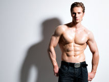 Handsome muscular young man posing at studio. Royalty Free Stock Images