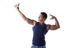 Handsome muscular young man taking selfie with cell phone Royalty Free Stock Photos