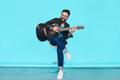 Handsome musician playing guitar Royalty Free Stock Image