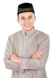 Handsome muslim man smiling. Portrait of handsome muslim man smiling with arm crossed on white background Stock Photo