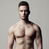 Handsome naked male. Fashion photo of naked male with strong body Stock Photo