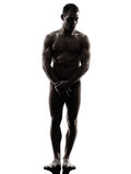 Handsome naked muscular man standing full length silhouette Royalty Free Stock Photo