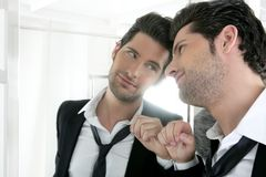 Handsome narcissistic young man in a mirror Stock Photo