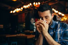 Handsome natural man drinking tea Stock Photo