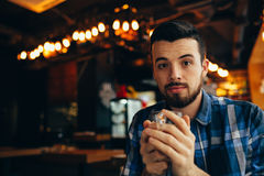 Handsome natural man looking at the camera and holding cup of tea Royalty Free Stock Photos