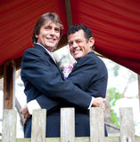 Handsome Newlywed Grooms in the Park Stock Photos