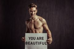 Handsome nice man saying compliments to you. Love yourself. Handsome nice man smiling while saying compliments to you royalty free stock photos