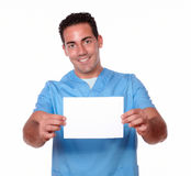 Handsome nurse guy holding a white card Stock Photo
