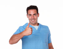 Handsome nurse man with postive sign. Portrait of a handsome nurse man on blue medical uniform with positive sign smiling and looking at you on isolated studio Royalty Free Stock Images