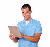 Handsome nurse man using his tablet pc Stock Photography