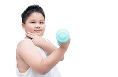 Handsome obese boy is doing exercises with dumbbells. Isolated on white background with copy space Stock Photo