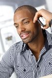 Handsome office worker on mobile call Royalty Free Stock Photos