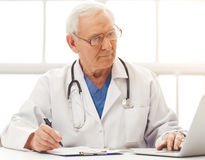 Handsome old doctor Royalty Free Stock Photo