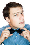 Handsome old-fashioned gentleman adjusting his bow tie Royalty Free Stock Photography