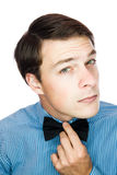 Handsome old-fashioned gentleman adjusting his bow tie Stock Photo