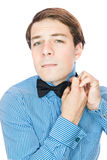 Handsome old-fashioned gentleman adjusting his bow tie Stock Photography