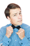 Handsome old-fashioned gentleman adjusting his bow tie Royalty Free Stock Images