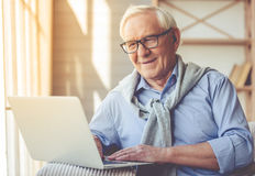 Handsome old man at home Stock Image