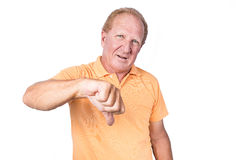 Handsome old man with orange polo-shirt shows thumb down royalty free stock images