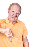 Handsome old man with orange polo-shirt shows thumb down stock photography