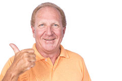 Handsome old man with orange polo-shirt shows thumb up Stock Photos