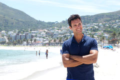 Handsome older man smiling at the beach Stock Photography