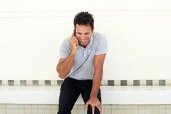 Handsome older man talking on mobile phone Stock Images