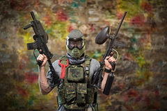 Handsome paintball gamer with guns Royalty Free Stock Image