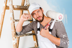 Handsome painter with paint brush Royalty Free Stock Images