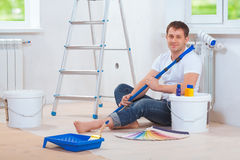 A handsome painter sitting on floor Royalty Free Stock Photo