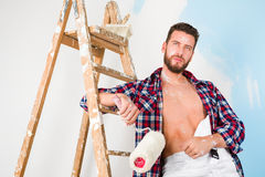 Handsome painter with unbottoned shirt Stock Photo