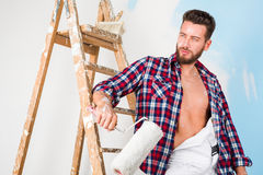 Handsome painter with unbottoned shirt Stock Images