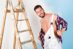 Handsome painter with unbottoned shirt Stock Photography
