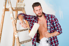Handsome painter with unbottoned shirt Stock Photos