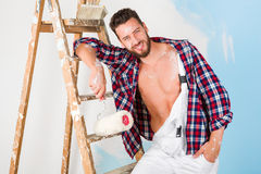 Handsome painter with unbottoned shirt Royalty Free Stock Images
