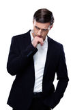 Handsome pensive businessman Stock Photo
