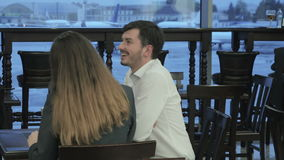 Handsome people have the conversation in the bar of the airport stock footage