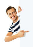 Handsome person pointing towards blank signboard Stock Photo